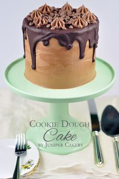 6-Inch Chocolate Chocolate Chip Layer Cake, filled with Bourbon Vanilla Buttercream hiding delicious gems of raw cookie dough, iced with Milk Chocolate Buttercream--drizzled with Dark Chocolate