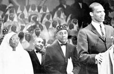 The Most Honorable Elijah Muhammad stands beside his wife Clara Muhammad with Minister Louis Farrakhan speaking Elijah Muhammad, Muhammad Ali, Remember The Titans, Black Leaders, Black Fathers, Civil Rights Leaders, Black Panther Party, My Black Is Beautiful, Beautiful Images