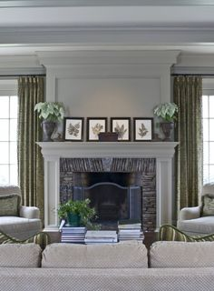 Living room FP --- I really like the way the crown moulding here echoes the fireplace mantel, and I like the stone surround a lot, too.