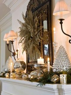 Make it shine  Group a variety of mercury glass and silver ornaments, votive holders and other accents to create a mirror-like display, especially pretty at night when candles shimmer off the reflective surfaces. A wreath of fern fronds adds sophistication.