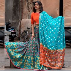 Blue and Orange Button Down Gamthi Style Chaniya Choli. This blue and orange chaniya choli is different and sophisticated. It has button down pattern on the choli which looks amazing! Choli Blouse Design, Choli Designs, Blouse Designs, Choli Dress, Lehenga Choli, Anarkali, Sarees, Dress Skirt, Gujarati Chaniya Choli