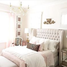 Note to self:  put my linen headboard in guest room and order it in this ivory .  gorgeous bedroom! I love the pops of leopard print with the pastels + neutrals: