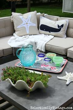 Love this patio! The concrete coffee table is beautiful and the sectional sofa is a cozy place to curl up eclecticallyvintage.com