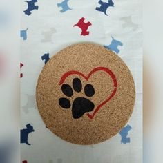 Hand painted cork drink coasters with paw print and a heart