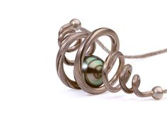 Ezra Satok-Wolman. Necklace: Orbit, 2007. 750 white gold, Shakudo, Tahitian pearl. 5.1 x 2.5 x 2.5 cm. Mokume gane, forged, fabricated, oxidized, hand woven chain.