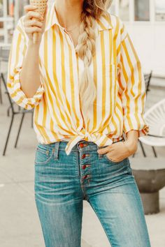 Yellow and white striped top, high waist blue jeans, white gold star sneakers. Fashion Bloggers, Fashion Style, Sheridan Gregory, Fashion Style for Summer, Summer outfit, spring outfit, long blonde hair, side braid, summer trends, spring trends. #womenstyle #womenfashion #springtrends #springstyle #SheridanGregory #Style