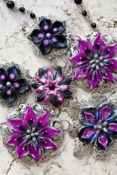 lovely polymer clay & filigree flowers from Rockybeads flickr site at http://www.flickr.com/photos/14837871@N02/4940752611/in/set-72157622923279419/  -     also check out her blog at   http://www.blogger.com/profile/05544718787778708430