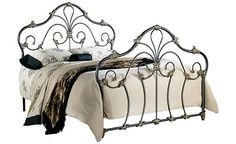 """Marcella Queen / Full Metal Bed - Price not given    The """"Marcella"""" metal bed is an absolutely inspiring piece that has shaped metal into a flourish of curls and elaborate accenting. The dark, rich color swirls beautifully throughout the elegant ornamentation that dresses this bed in pure splendor."""