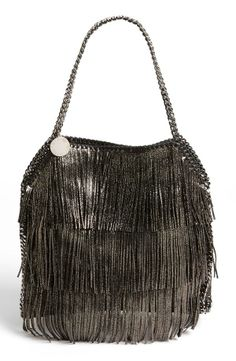 We love this faux leather fringe tote.