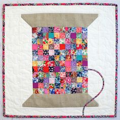 Vintage Cotton Reel Mini Quilt, pattern by Tied with a Ribbon. Liberty fabrics