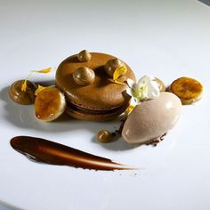 Want to get featured? Tag your photos with #TheArtOfPlating .. Coffee chocolate macaron with brûlée bananas, and coffee cream, milk chocolate sorbet by @bachour1234 #TheArtOfPlating