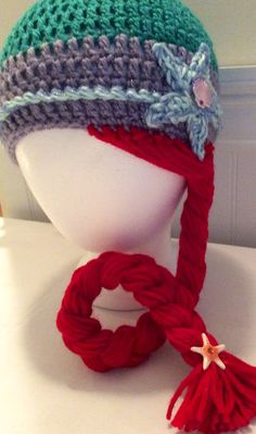 This sweet Ariel hat is handmade with love, using only the softest, high quality yarn. This darling hat is adorned with a sparkly starfish