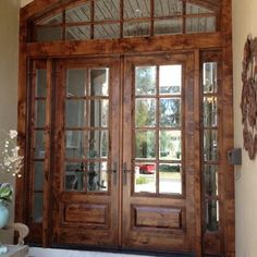 Ponte Vedra - Heckard's Door 8-0-8-0 Entry unit with transom. This custom made entry door consists of Knotty Alder wood and beveled glass in...
