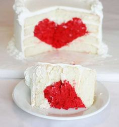 Cake stuffed with a heart - perfect for Valentine's day (or the top tier on a wedding cake *gush*)