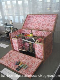 This fancy French sewing box is paper-covered and the interior is compartmentalized to accommodate nifty notions like thread and a toy sewing machine.
