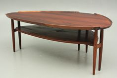 The organic coffee table in rosewood designed by Arne Vodder, Denmark. www.reModern.dk
