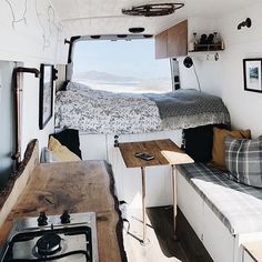 camper van with live-edge counters upholstered banquette in gray white and wo Tiny House Living Room banquette Camper counters Gray liveedge Upholstered van White