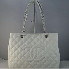 Ashley Tisdale wearing Chanel Quilted Classic Caviar Handbag.