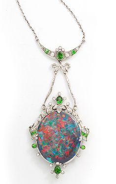 Black opal, diamond, and demantoid garnet pendant mounted in platinum.  American, 1925