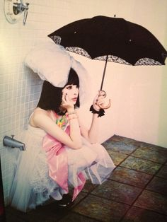 Cool Japanese girl with an umbrella.