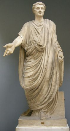 The toga is probably the most popular dress form associated with Rome. Typically worn by men, the toga has many colors and draped styles. Slaves, foreigners, and chaste adult women were not allowed to wear this garment.