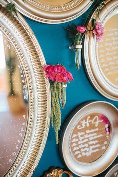 mirror wall seating chart - photo by Gina Meola Photography http://ruffledblog.com/gem-toned-garden-wedding-in-arizona