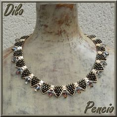 """Necklace with twin beads by """"Le perles de Pencio"""".  You can find a Pdf of the instruction on site."""