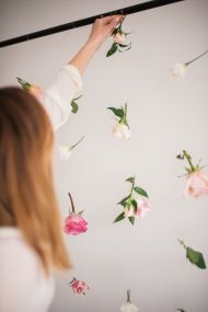 Give your party a beautiful backdrop with this super easy DIY floating flower wall! Perfect for birthdays, showers and gatherings alike.