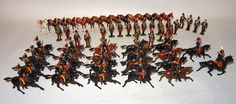 Lot 279 - Britains neatly repainted or converted 11th Hussars 18 on foot with fifteen horses, twenty-two
