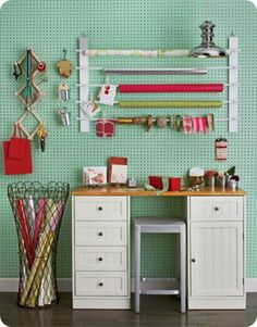 I have been wanting to do a variation of this idea for many years! I want to paint a large peg board and put store-bought wood trim around as a frame and hang scrapbooking supplies on it.