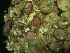 This is my skillet surprise! Fried potatoes with onions, scrambled eggs, scallions, and kielbasa.