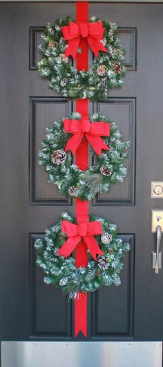 Front door Christmas Decorations but I would do each wreath different same color just different pattern for each one!
