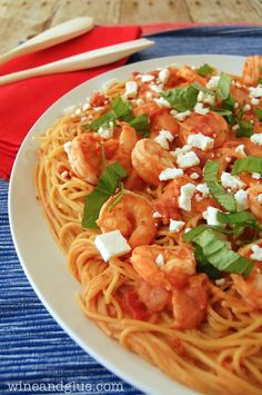 Creamy Tomato Pasta and Shrimp  |  A delicious, creamy, and rich dish that will feed a crowd! via www.wineandglue.com
