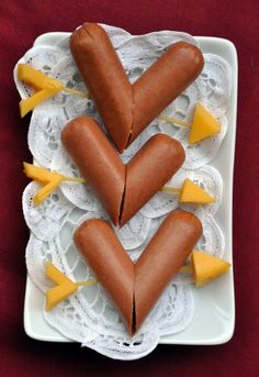 Hot dog hearts. Henry would love this for a Valentine lunch. Ketchup hearts too!