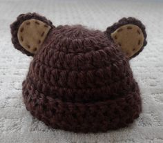 Kristy, this is the pattern I used for the hats with ears.    All About Ami - Pattern: Newborn Teddy Hat