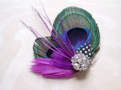 Wedding Hair Accessories, Peacock Bridal Fascinator Feather Hair Piece, feather hair clip purple violet. $32.00, via Etsy.