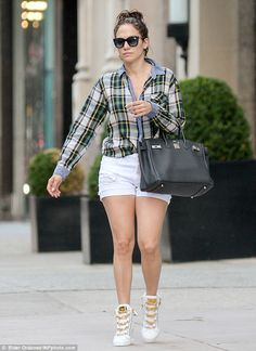 Gold laces: The 45-year-old singer showed off her toned legs with white shorts and trendy wedge sneakers