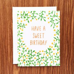 """Birthdays are sweet occasions! This birthday card features hand-painted oranges and vines. """"Have a Sweet Birthday"""" is hand-lettered in orange. Available as a single card paired with a 100% recycled wh"""