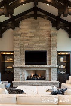 A luxurious family room in Park City, Utah by Cameo Homes Inc. Utah's Custom Home Builders. Home Fireplace, Fireplace Design, Fireplace Ideas, Fireplace With Stone, Fireplace In Kitchen, Stone Veneer Fireplace, Stacked Stone Fireplaces, Family Room Fireplace, Home Living Room