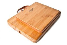 Hand made from a solid sheet of bamboo with leather straps, CNC machined parts, and two coats of poly. That describes the heavy-duty cases made by Silva Limited for your MacBook or your iPad (Thanks, Dave!