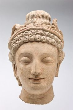 Head of a Bodhisattva, 5th century Sculpture , Head Afghan , 5th century Kushan period, c.100 BC-250 AD Creation Place: Hadda, Afghanistan Stucco with traces of polychromy; Gandharan style, from Hadda, Afghanistan