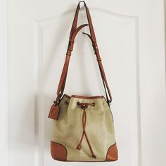 """Vintage Liz Claiborne LeatherDrawstring Cross Body Liz Claiborne Leather Cross Body  ·         Drawstring closure ·         Interior zipper pocket ·         ***a little dirty inside and out from use ·         Measures 9.5""""x5.5""""x10"""" ·         Strap 17"""" Liz Claiborne Bags Crossbody Bags"""