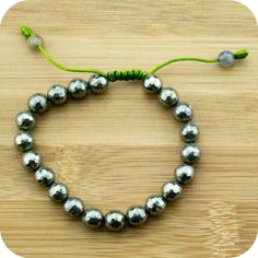This high quality wrist mala bracelet features faceted pyrite with jade tassel beads and an adjustable slipknot band. Pyrite is known traditionally for helping to attract abundance and good luck. It m