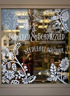BEDECKED & BEADAZZLED | This painted window may have been seen in winter but these simple floral & foliage shapes would look great as a #SpringWindowDisplay especially in a nice green hue. #springwindowdisplay #visualmerchandising