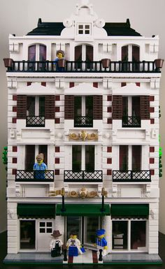 https://flic.kr/p/mB6awi | Lego Modular Hotel | A modular Parisian sort-of style hotel, featuring 2 basic rooms, 2 larger rooms, and a lovers' suite on the top floor, complete with a heart-shaped bed and wine bar. Also, a set of non-working elevators. I'm fairly happy with the way it turned out... still working on improving my interiors... I ran out of tiles by the top floor, hence the boring plain white plate floor.