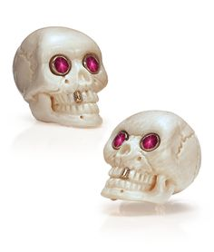 Cellini Jewelers NYC - Mammoth Bone Skull Cufflinks - Carved bone in a skull motif, with an accent yellow gold tooth, and star ruby eyes. Back closure is 18-karat white gold.