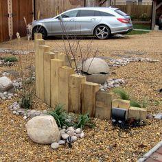 Oak sleeper wall in the front garden