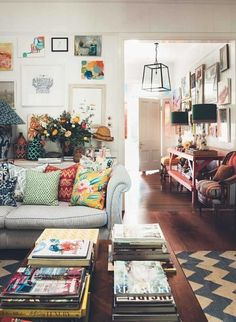 . Boho eclectic living room. Pillows. Wall art. Maximalism Home Decor Is Fall's Hottest Trend | Domino