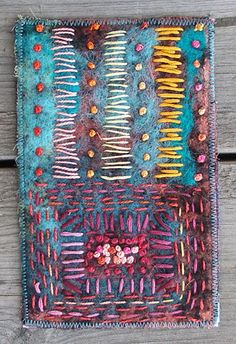 Handpainted scrim that is needlefelted on to wool and then handstitched.