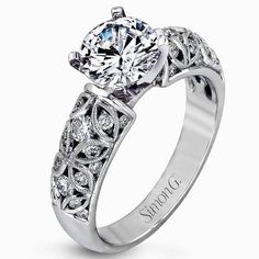 Intricate Filigree Diamond Engagement Ring from Simon G. and Ben Garelick Jewelers. http://qoo.ly/fcxjy